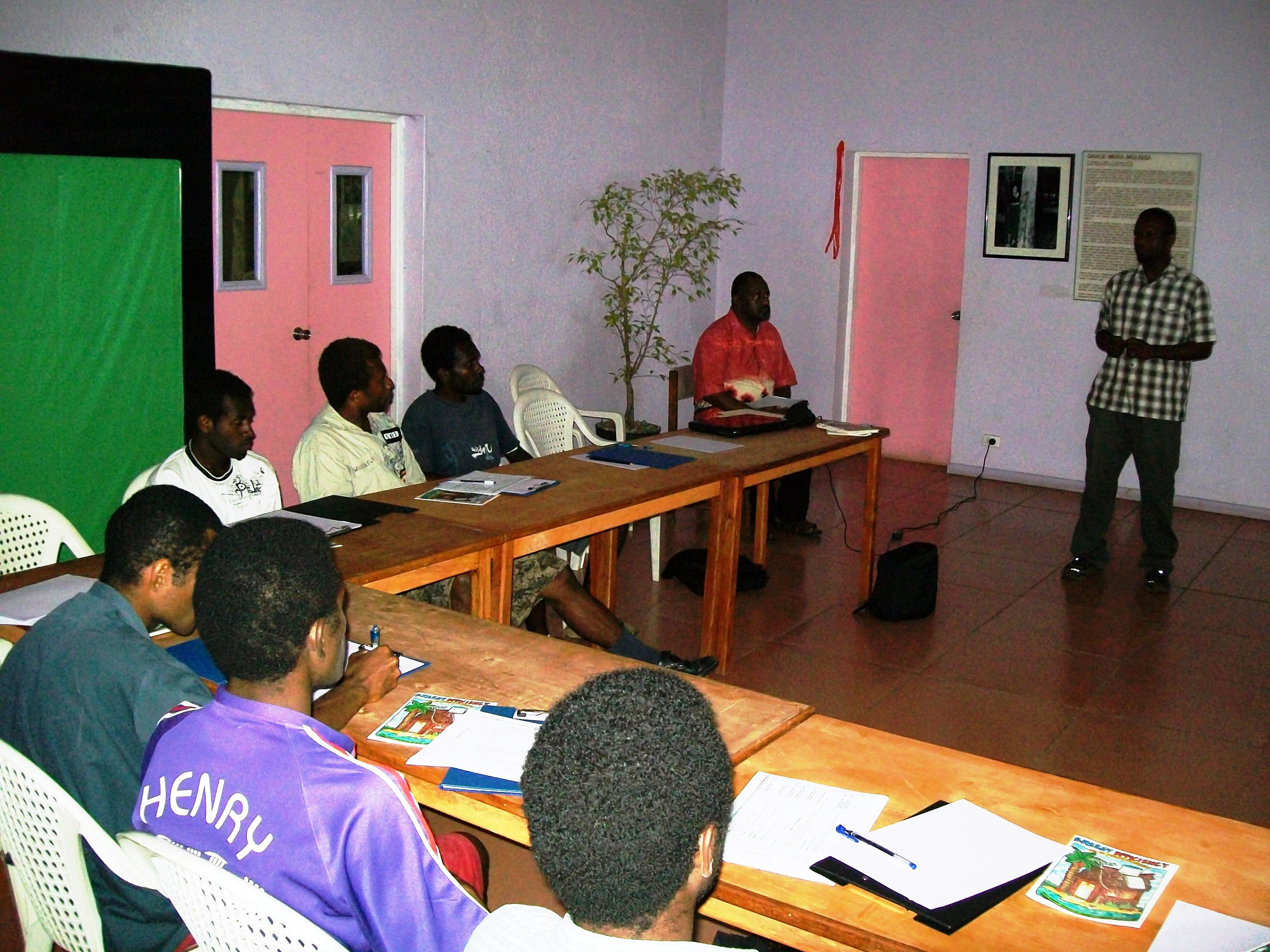 Participants of the Energy Efficiency Workshop listening to a presentation by an Energy Unit Officer.